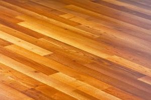 Diagonal lines of laminated hardwood parquet floor